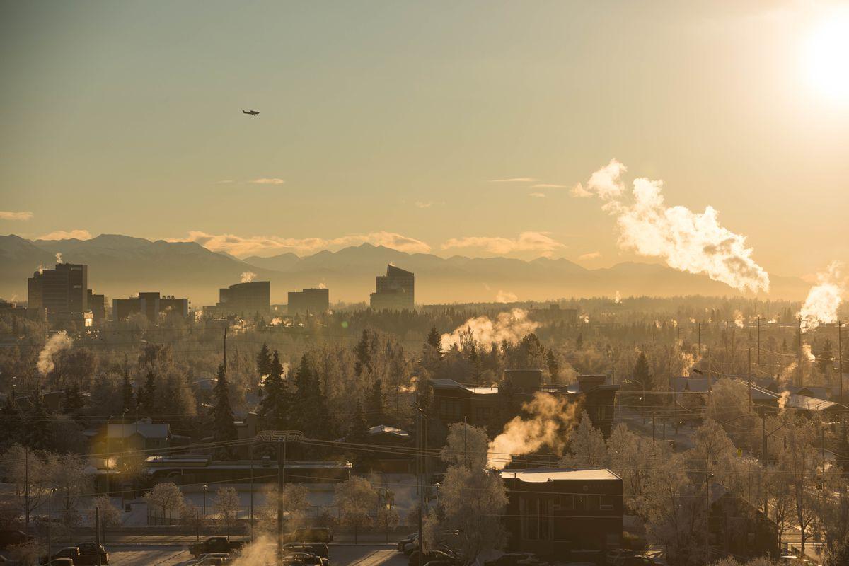 An airplane flies above Anchorage on Thursday, Dec. 22, 2016. (Loren Holmes / ADN)