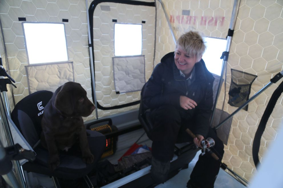 Rigby and Christine Cunningham inside their new ice shanty on Christmas day. (Photo by Steve Meyer)