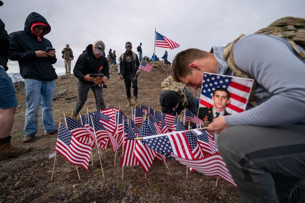 Spc. Karl Mordorff plants a flag atop Gold Star Peak Thursday, May 27, 2021 in Eklutna. Nearly 300 Paratroopers from the 4th Infantry Brigade Combat Team (Airborne), 25th Infantry Division hiked to the top of the 4,148-foot summit to honor the 77 fallen paratroopers from the 4-25. (Loren Holmes / ADN)
