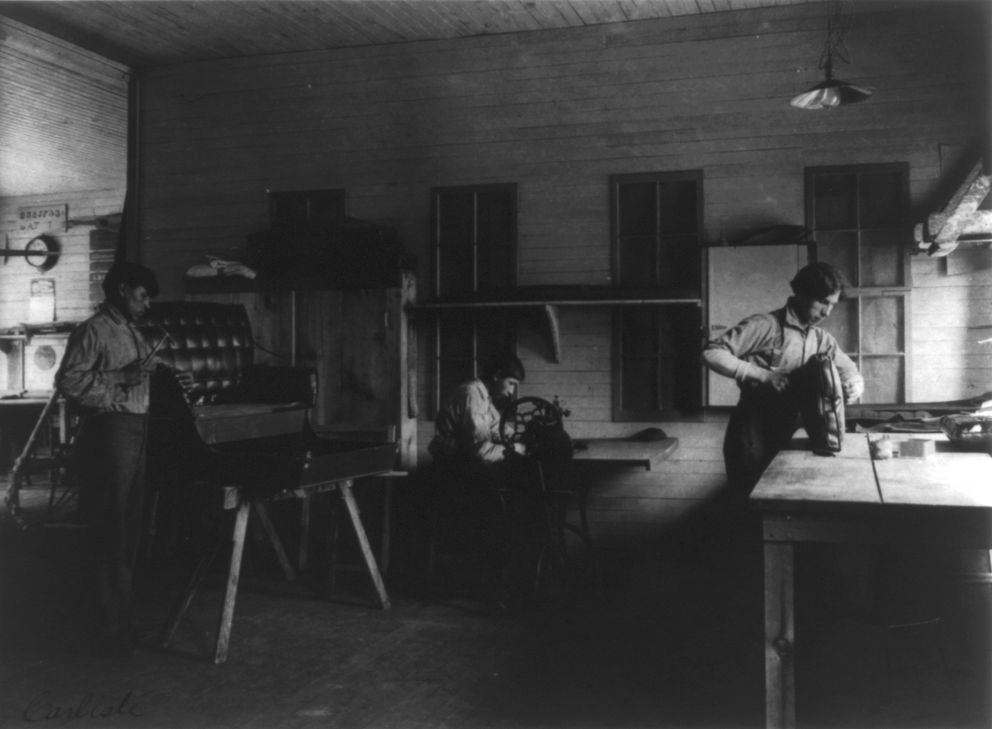 Native American boys work in the carriage shop at the Carlisle Indian Industrial School in 1901. (Photo by Frances Benjamin Johnston courtesy of Library of Congress)