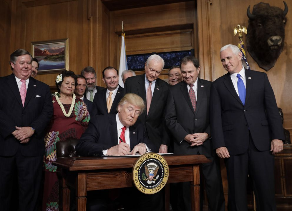 President Donald Trump signs an executive order reviewing previous national monument designations at the Interior Department in Washington, April 26, 2017. REUTERS/Kevin Lamarque