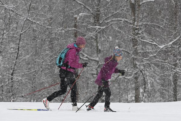 Lili Leveque and her daughter Colette, 8, glide across the fresh snow while nordic skiing at Russian Jack Springs Park on Sunday, Nov. 8, 2020. (Bill Roth / ADN)