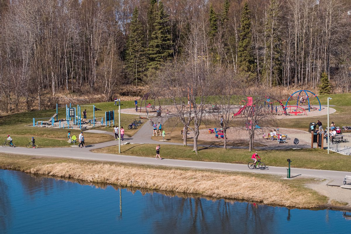 People enjoy warm weather at Westchester Lagoon on Saturday, May 9, 2020 in Anchorage. (Loren Holmes / ADN)