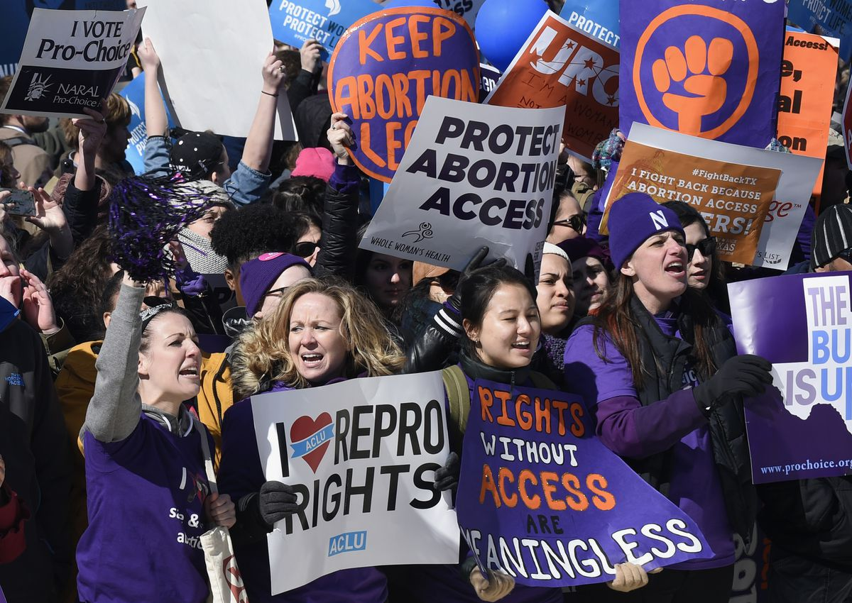 File: Pro-abortion rights protesters rally outside the Supreme Court in Washington, Wednesday, March 2, 2016. (AP Photo/Susan Walsh)
