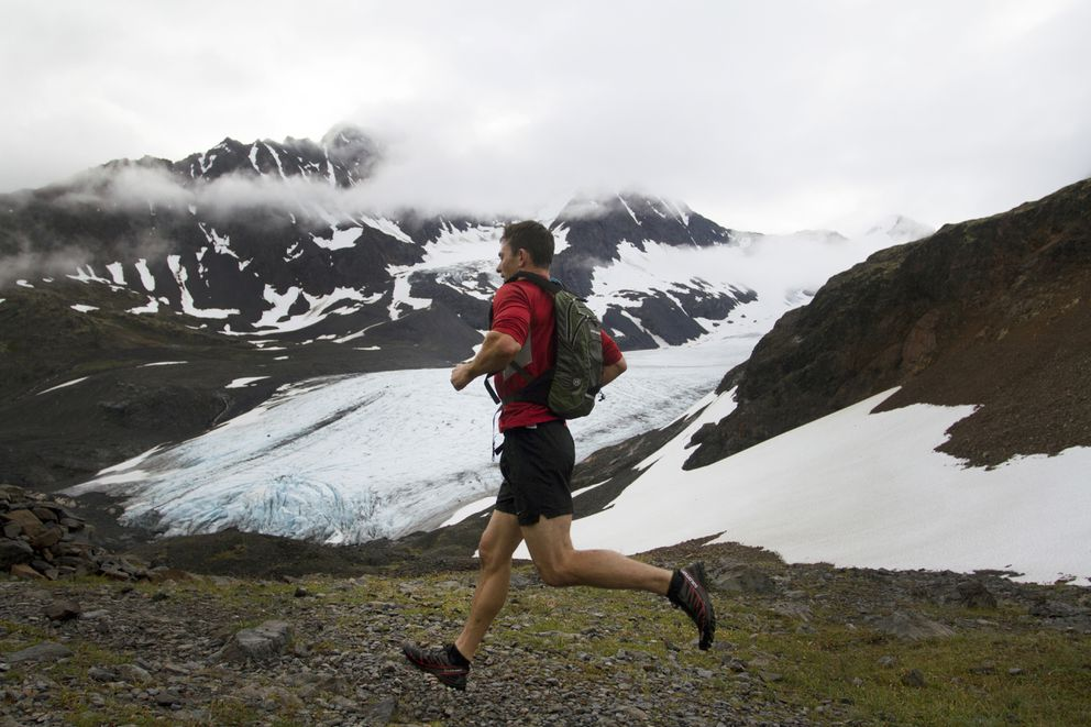 A runner passes Raven Glacier as he descends Crow Pass, a high point of the nearly marathon-length wilderness race, during the 33rd annual Crow Pass Crossing. July 23, 2016. (Sarah Bell / Alaska Dispatch News)