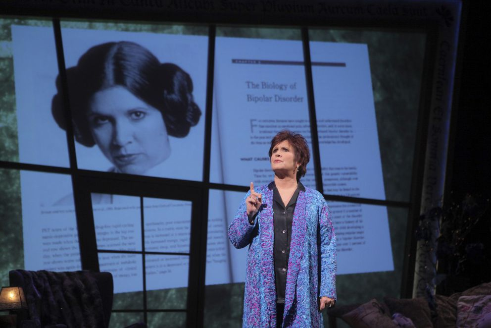 """FILE — Carrie Fisher on stage in her autobiographical show """"Wishful Drinking,"""" at Studio 54 in New York, Sept. 24, 2009. Fisher, who brought a rare combination of nerve, grit and hopefulness to the role that made her an overnight movie star, Princess Leia in """"Star Wars,"""" died in Los Angeles on Dec. 27, 2016, days after suffering a heart attack on a flight. She was 60. (Sara Krulwich/The New York Times)"""