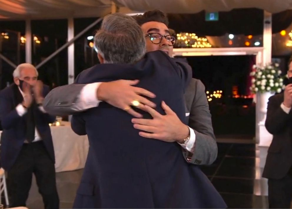 In this video grab captured on Sept. 20, 2020, courtesy of the Academy of Television Arts & Sciences and ABC Entertainment, Eugene Levy, left, hugs his son Daniel Levy, winner of the award for outstanding writing for a comedy series for 'Schitt's Creek ' during the 72nd Emmy Awards broadcast. (The Television Academy and ABC Entertainment via AP)