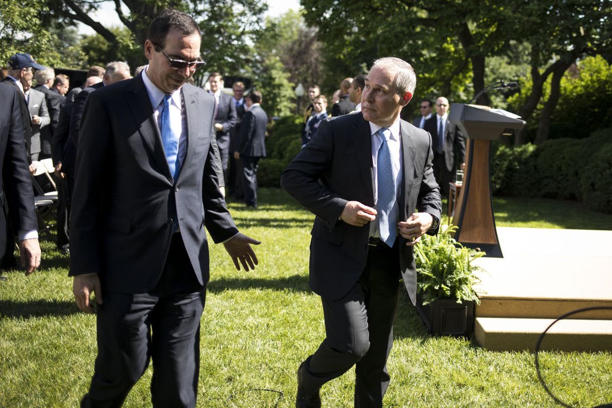 Treasury Secretary Steven Mnuchin, left, and Environmental Protection Agency Administrator Scott Pruitt depart after President Donald Trump spoke about the U.S. role in the Paris climate change accord, Washington, June 1, 2017. (Al Drago/The New York Times file)