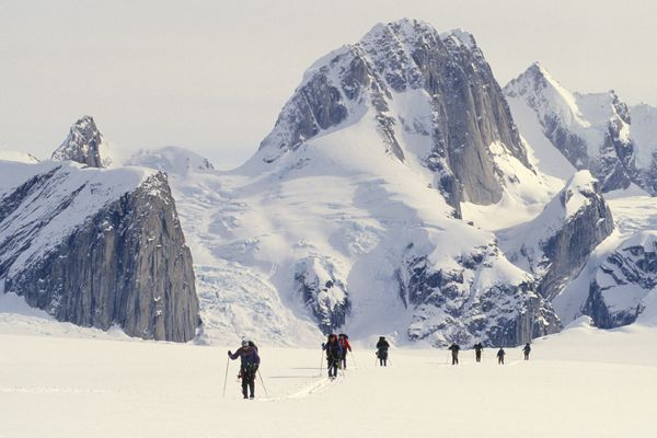 The Moose's Tooth formation is the backdrop for skiers as they traverse the Ruth Glacier in Denali National Park in April 1995. (Fran Durner / ADN)