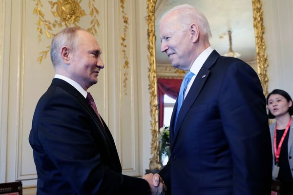 U.S President Joe Biden, center, and Russian President Vladimir Putin, left, shake hands during their meeting at the 'Villa la Grange' in Geneva, Switzerland in Geneva, Switzerland, Wednesday, June 16, 2021. Russian President Vladimir Putin thanked President Joe Biden and expressed wishes for a