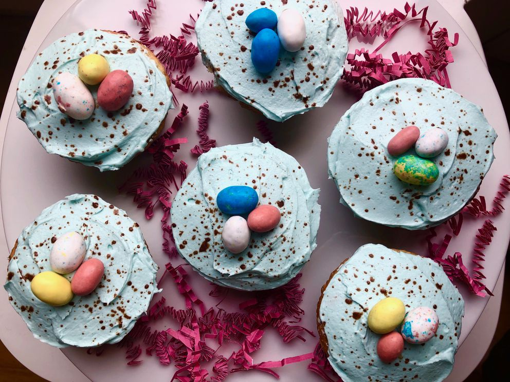Robin's egg-style butter cream frosting on Easter cupcakes, made by spattering a mixture of cocoa and water. (Julia O'Malley/ADN)