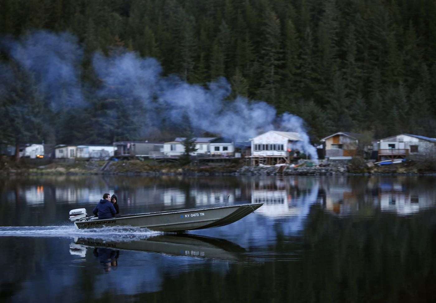 People cross Eyak Lake in a skiff and dock on a small gravel beach on the lake's west side just after sunset in Cordova on Monday, May 17, 2021. (Emily Mesner / ADN)