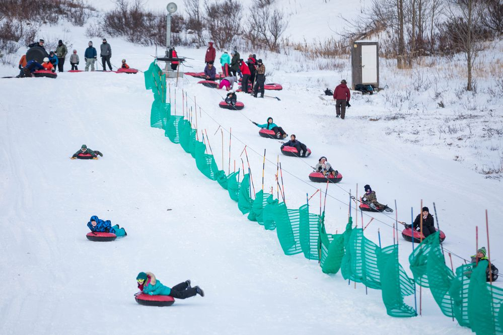 Tubers enjoy the first session of the year at Arctic Valley on Saturday, Dec. 31, 2016. The tubing hill is the only part of the ski area that is open, the ski hill needs a few more inches of snowfall before they can open for the season. (Loren Holmes / Alaska Dispatch News)