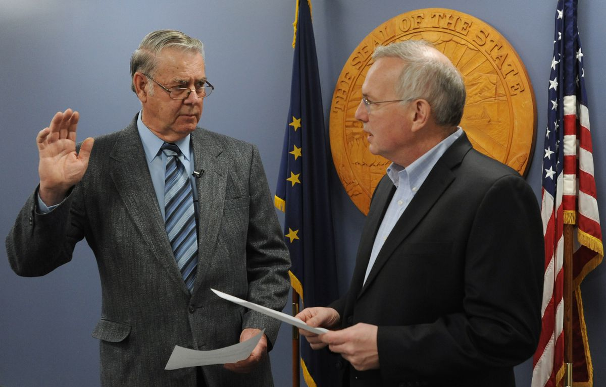 Mel Gillis, a Republican from South Anchorage, was sworn in by Bryce Edgmon, Speaker of the Alaska House of Representatives, in Anchorage on Monday, Dec. 2, 2019. (Bill Roth / ADN)