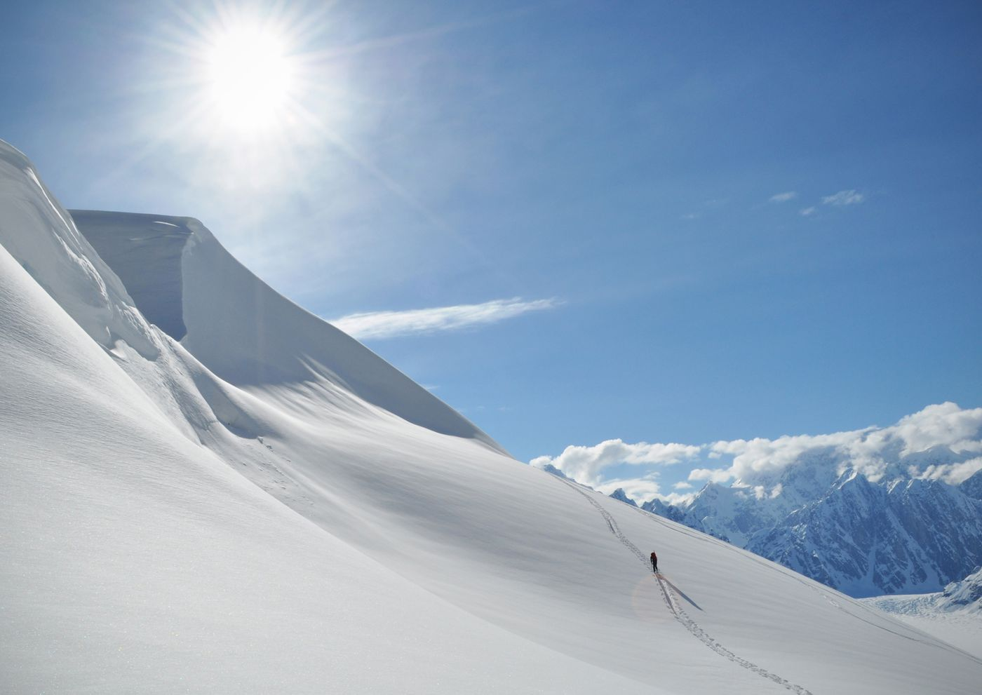 Matt Cress skins up a slope near camp. (Vicky Ho / ADN)