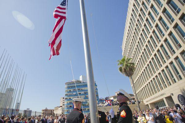 U.S. Marines raise the U.S. flag over the newly reopened embassy in Havana, Cuba. Friday.