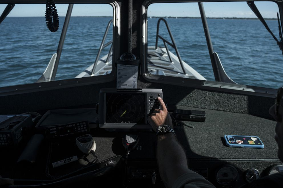 An agent with United States Customs and Border Protection checks the radar while on Lake Huron on the border between the U.S. and Canada, Sept. 20, 2016. The Northern border of the United States is nearly three times the Southern border's length, but the Border Patrol in the North makes do with about one-tenth the manpower. (Sean Proctor / The New York Times)