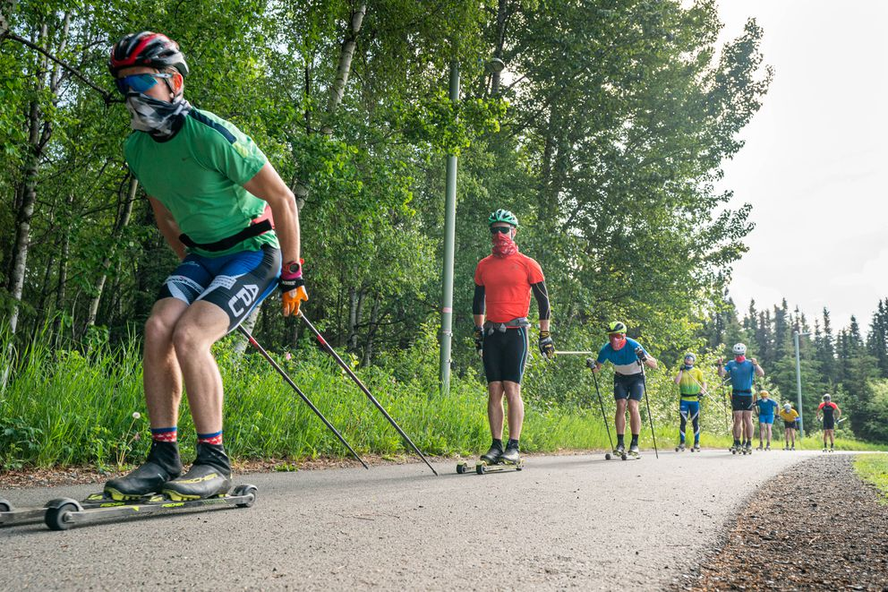 APU rollerskiers cruise down the Chester Creek trail. (Loren Holmes / ADN)