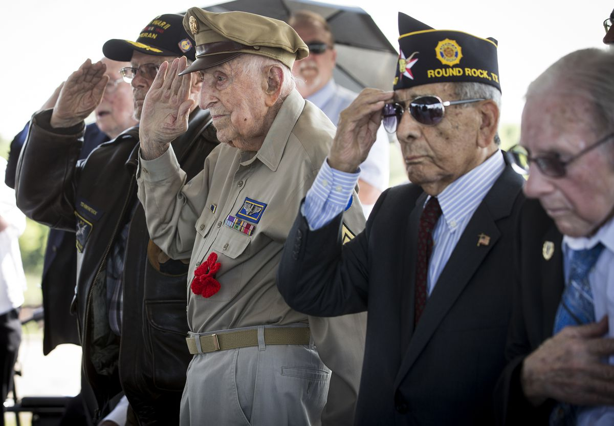 D-Day veterans, from left, Teddy Kirkpatrick, Achilles Kozakis and Robert Sanchez salute during a ceremony aboard the Battleship Texas on Thursday, June 6, 2019, in La Porte, Texas. The U.S.S. Texas was part of the D-Day operations in Normandy and is the last remaining battleship to have served during the invasion. The veterans were all awarded the French Legion of Honor for their service in the liberation of France. (Brett Coomer/Houston Chronicle via AP)