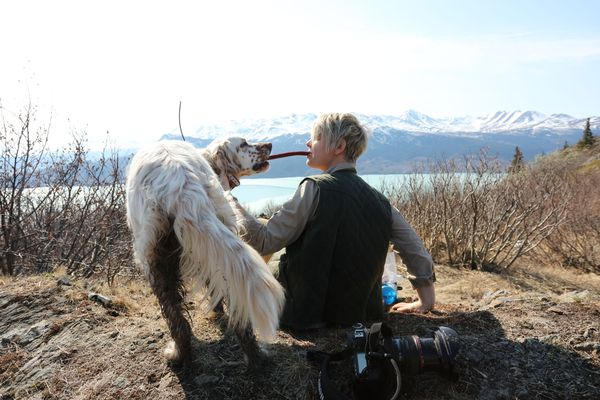 Hugo and Christine Cunningham share a pepperoni stick as they take a break along the Skilak Lookout Trail on the Kenai National Wildlife Refuge. (Photo by Steve Meyer)