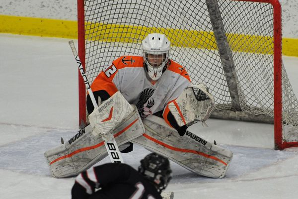 West High senior goalie Connor Batman watches a shot by Juneau-Douglas senior forward Jacob Dale during the Eagles' 6-1 victory over the Crimson Bears during the opening game of the First National Cup state hockey championship at the Menard Center in Wasilla on Thursday, Feb. 8, 2018. (Bill Roth / ADN)