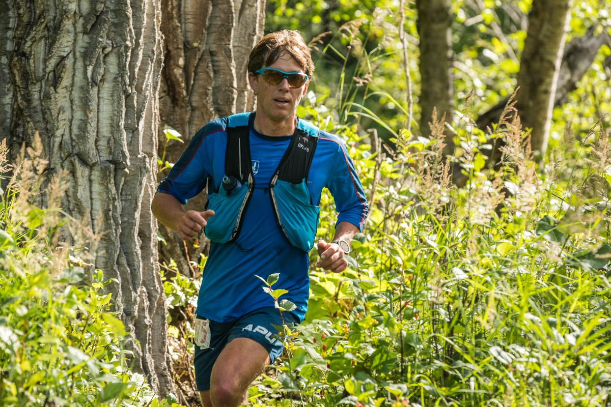 Scott Patterson runs toward Dishwater Creek on his way to his fifth victory in the Crow Pass Crossing. (Loren Holmes / ADN)