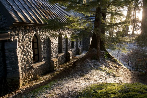 Sunlight hits the stone walls of the chapel at the National Shrine of St. Therese, located about 22 miles north of Juneau, on January 21, 2017. (Marc Lester / Alaska Dispatch News)