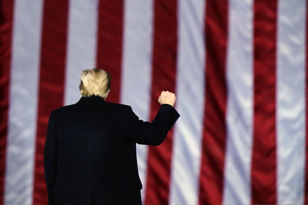 FILE - In this Monday, Jan. 4, 2021, file photo, President Donald Trump gestures at a campaign rally in support of Senate candidates Sen. Kelly Loeffler, R-Ga., and David Perdue in Dalton, Ga. (AP Photo/Brynn Anderson, File)