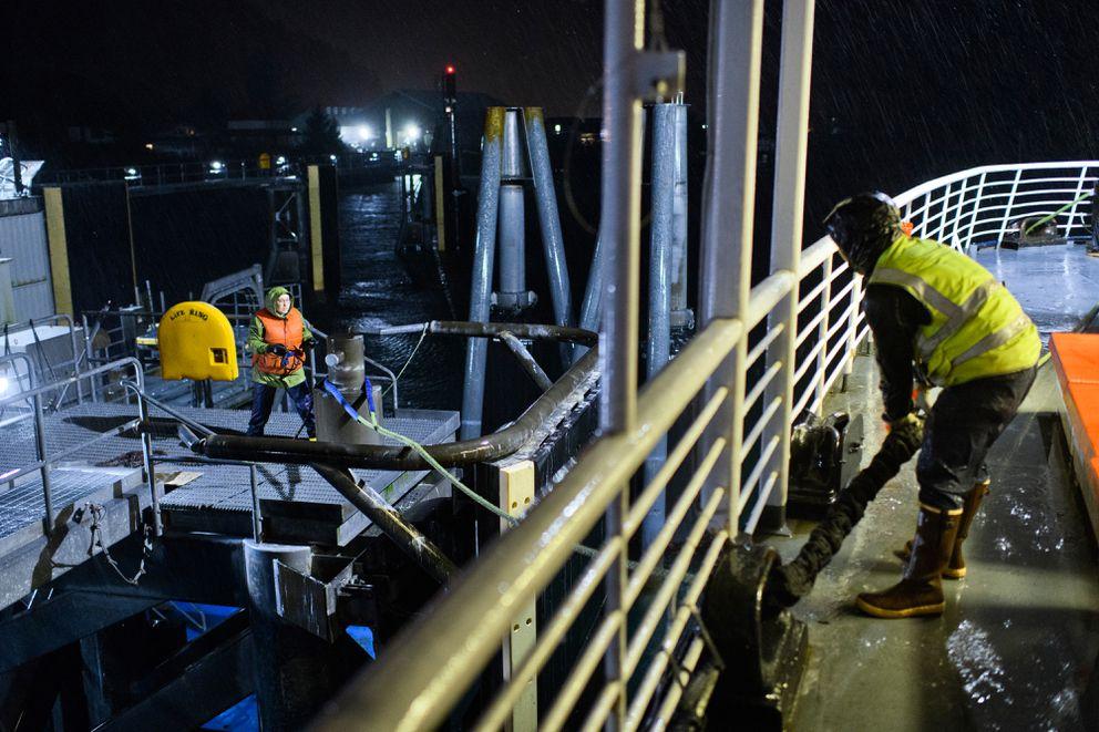 Alaska Marine Highway staff members prepare the ferry Aurora to depart Cordova on Sept. 18, 2019. (Marc Lester / ADN)