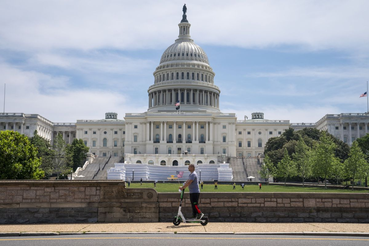 A person rides an electric scooter near the U.S. Capitol in Washington on May 15, 2020. (Bloomberg photo by Sarah Silbiger)