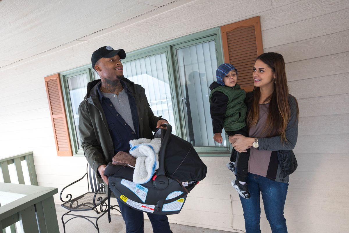 David Dumpson, holding newborn Kahleel, and fiancee Hannah Johnson, holding their 2-year-old son Kohen, check out an apartment in East Anchorage on Tuesday. (Loren Holmes / ADN)