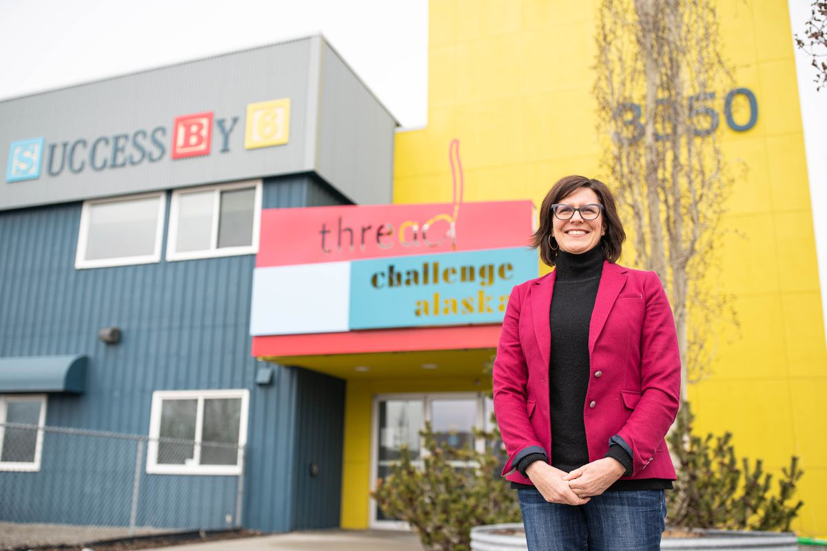 Thread CEO Stephanie Berglund stands outside her office on Thursday, April 16, 2020, in Anchorage's Mountain View neighborhood. Thread is a nonprofit that works to increase access to affordable early child care for Alaska families. (Loren Holmes / ADN)
