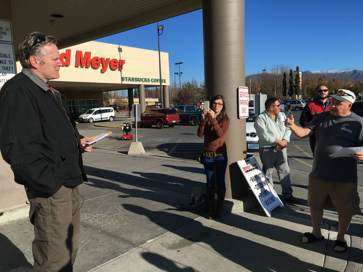 Paul Kendall, a write-in Republican candidate for U.S. Senate, spars with Wasilla Republican Sen. Mike Dunleavy outside the Muldoon Fred Meyer store on Wednesday. (Nathaniel Herz / Alaska Disptach News)