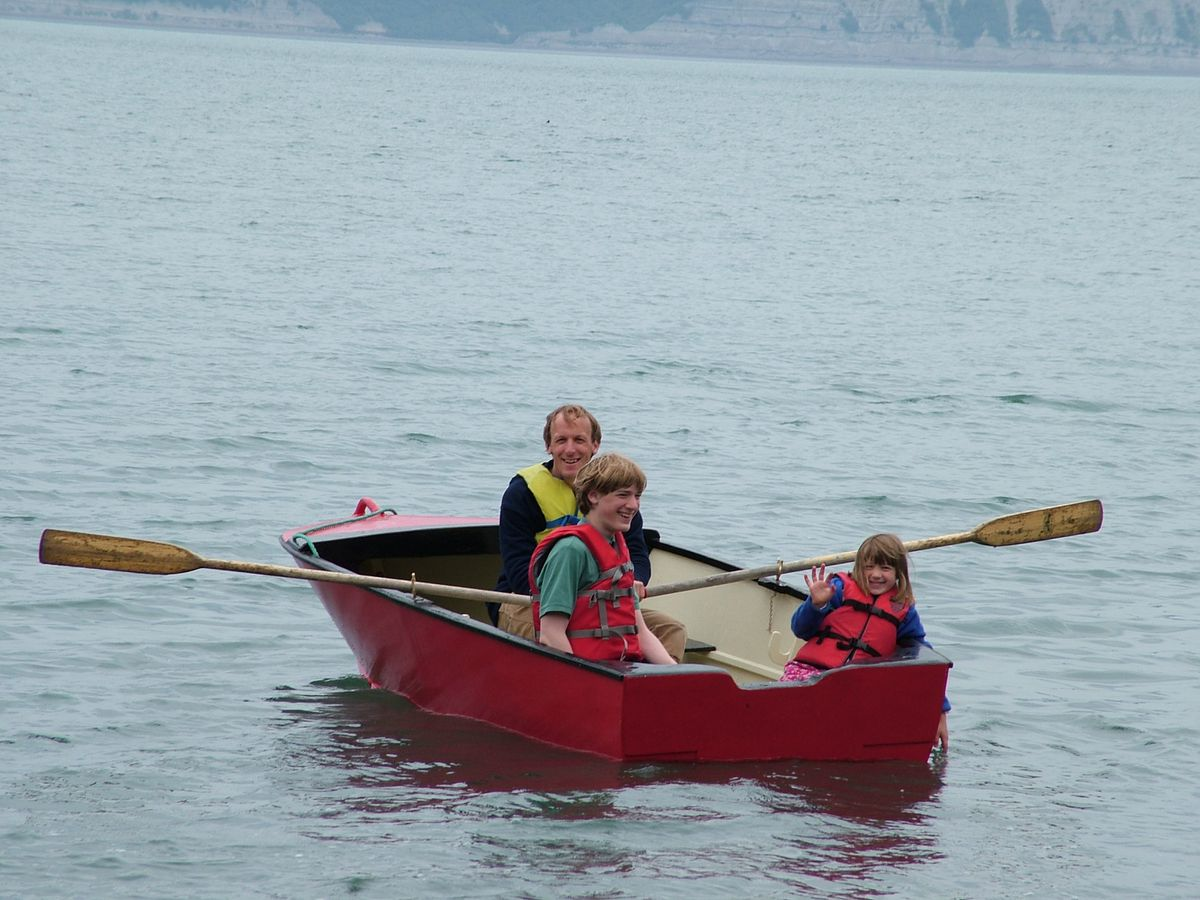 The author paddling in his rowboat in Kachemak Bay in 2006 with his son, Robin, and daughter, Becky. (Courtesy Charles Wohlforth)