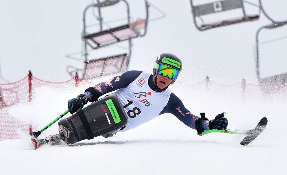 Andrew Kurka carves a turn en route to claiming the gold medal in a super-G race inMarch in Hakuba, Japan. (Photo by Yasushi Yamawaki)