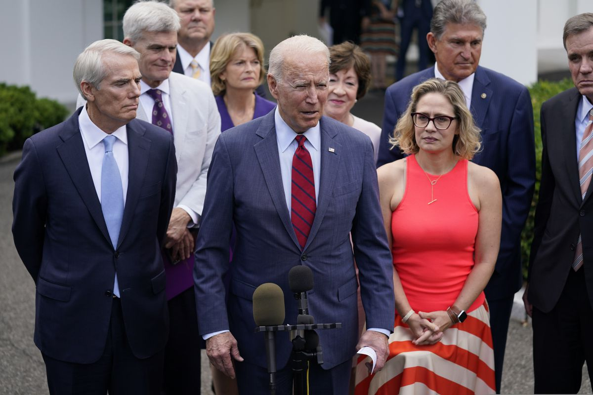 President Joe Biden, with a bipartisan group of Senators, speaks Thursday June 24, 2021, outside the White House in Washington. Biden invited members of the group of 21 Republican and Democratic senators to discuss the infrastructure plan. (AP Photo/Evan Vucci)