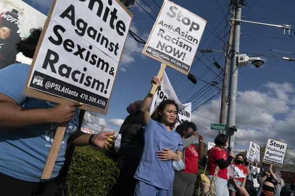 Kitana Truong joins others in rallying against anti-Asian and anti-female violence on Thursday in Atlanta. Georgia's hate-crimes law includes race, gender and national origin in its protected categories, making it potentially applicable to this week's shootings. MUST CREDIT: Photo by Elijah Nouvelage for The Washington Post