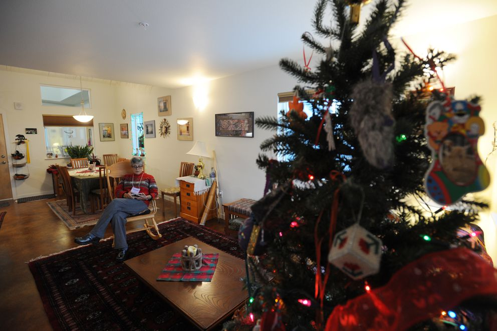 Yolanda Meza relaxes in the living room on Dec. 11 of the three-bedroom home that she purchased at Ravens' Roost, Anchorage's first cohousing neighborhood. (Bill Roth / Alaska Dispatch News)