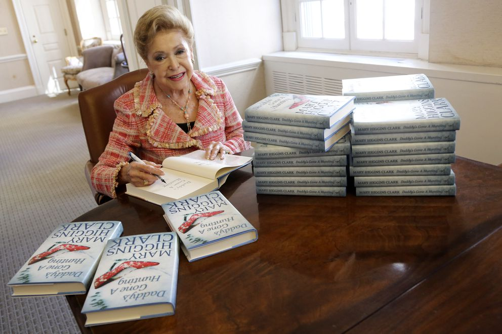 FILE - In this April 3 2013, file photo, author Mary Higgins Clark sign copies of her latest book 'Daddy's Gone A Hunting ' at the Simon & Schuster office in New York. Clark, 92, was the tireless and long-reigning 'Queen of Suspense ' whose tales of women beating the odds made her one of the world's most popular writers died Jan. 31, 2020. (AP Photo/Mary Altaffer, File)