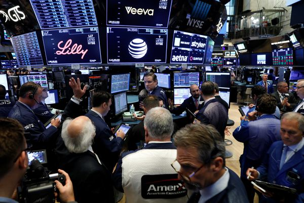 The AT&T logo is seen on a monitor near traders on the floor of the New York Stock Exchange (NYSE) in New York City, U.S. June 13, 2018. REUTERS/Brendan McDermid