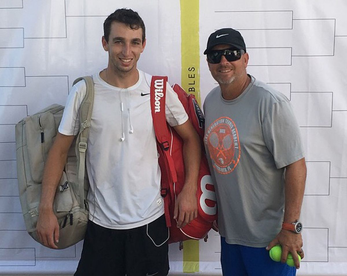 Eddie Lewis, left, poses with his coach, Travis Eckert, at an International Tennis Federation Futures tournament last November in Monterrey, Mexico. (Photo by Andrew Aufseeser)