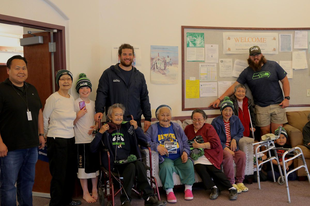 Seattle Seahawks offensive linemen Joey Hunt and Jordan Roos visited the Lulu Herron Elders Home in Bethel on July 11, 2018. (Aleina Tanabe / KYUK)