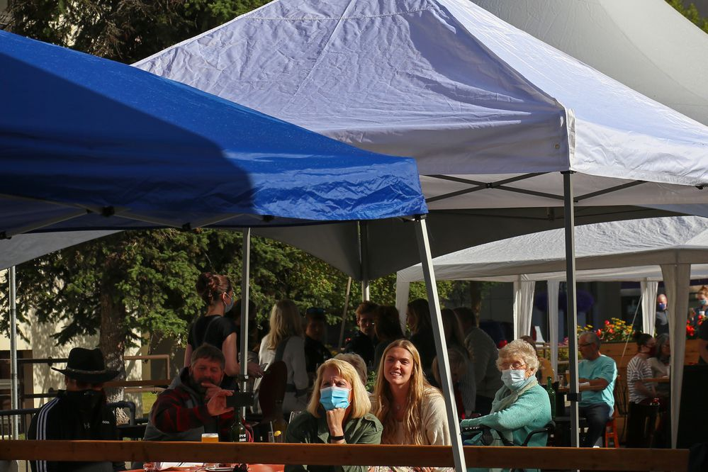 People dine in the outdoor seating area on G Street and listen to live music in Anchorage on Aug. 7, 2020. (Emily Mesner / ADN)