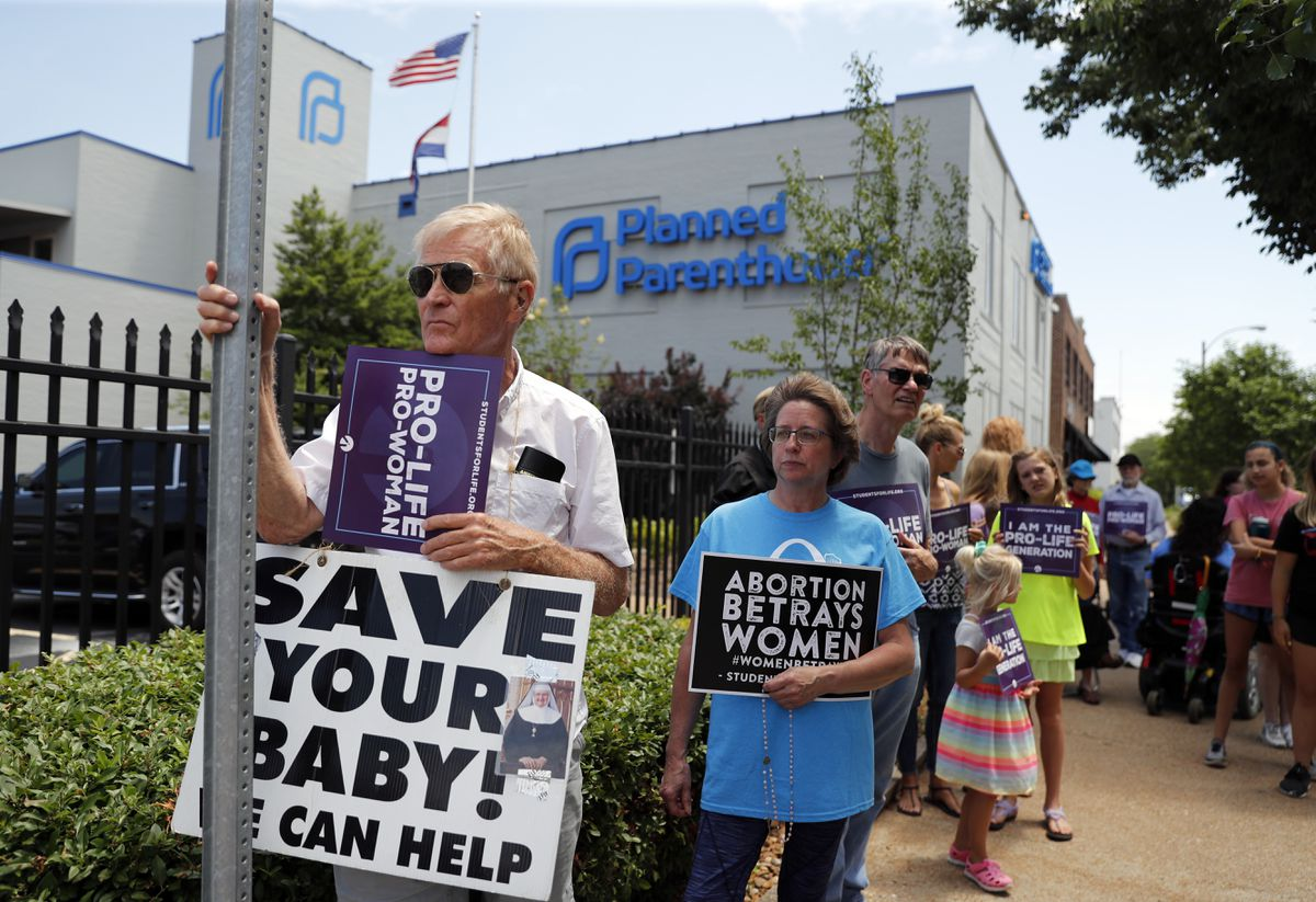 Anti-abortion advocates gather outside the Planned Parenthood clinic Tuesday, June 4, 2019, in St. Louis. A judge is considering whether the clinic, Missouri's only abortion provider, can remain open. (AP Photo/Jeff Roberson)