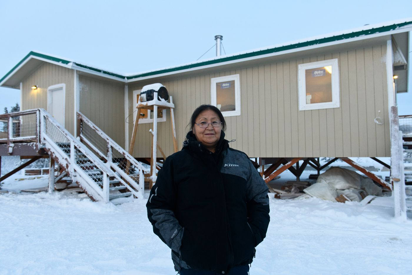 Hannah Coffin stands in front of the home that is under construction that her family will occupy. (Marc Lester / ADN)
