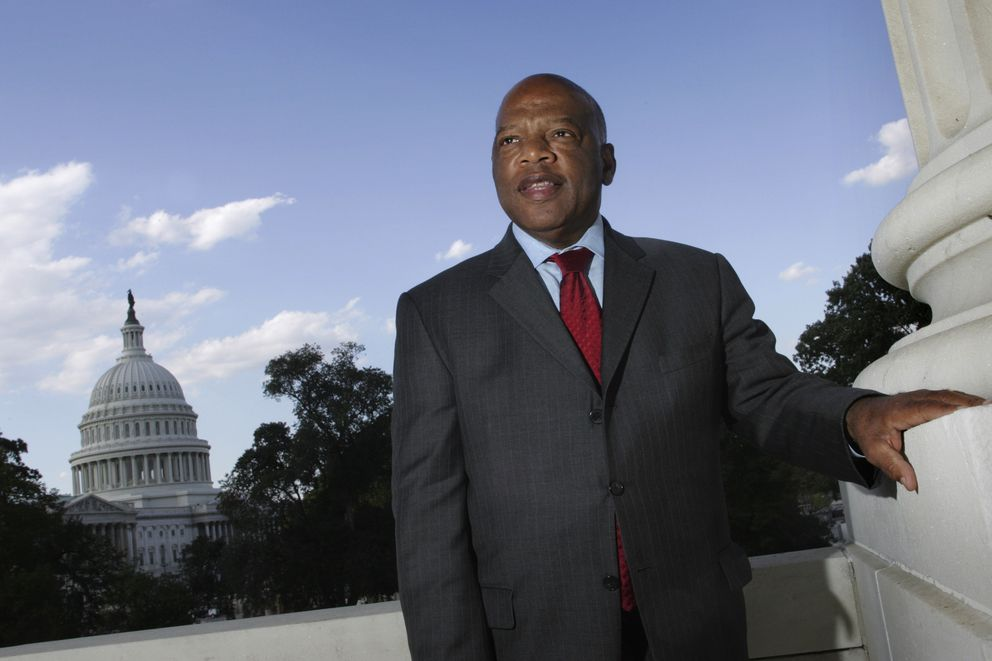 FILE - In this Oct. 10, 2007, file photo, with the Capitol Dome in the background, U.S. Rep. John Lewis, D-Ga., poses on Capitol Hill in Washington. Lewis, who carried the struggle against racial discrimination from Southern battlegrounds of the 1960s to the halls of Congress, died Friday, July 17, 2020. (AP Photo/Lawrence Jackson, File)