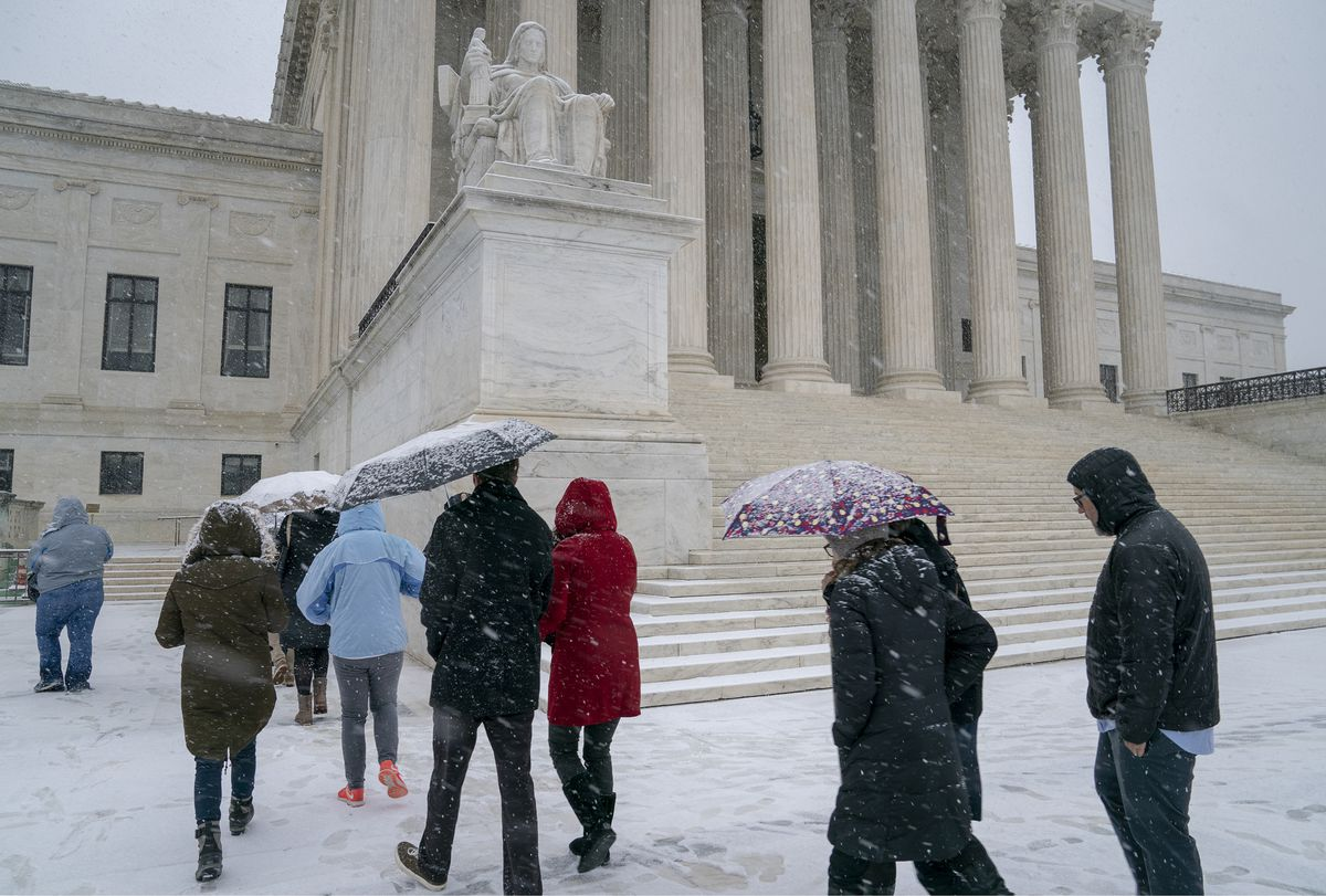 Visitors enter the Supreme Court as a winter snow storm hits the nation's capital making roads perilous and closing most Federal offices and all major public school districts, on Capitol Hill in Washington, Wednesday, Feb. 20, 2019. (AP Photo/J. Scott Applewhite)