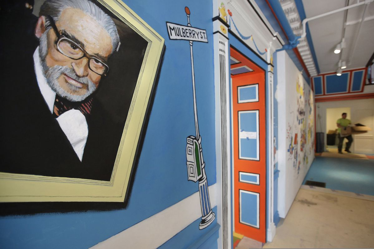 FILE - In this May 4, 2017, file photo, a mural that features Theodor Seuss Geisel, left, also known by his pen name Dr. Seuss, covers part of a wall near an entrance at The Amazing World of Dr. Seuss Museum, in Springfield, Mass. Dr. Seuss Enterprises, the business that preserves and protects the author and illustrator's legacy, announced on his birthday, Tuesday, March 2, 2021, that it would cease publication of several children's titles including