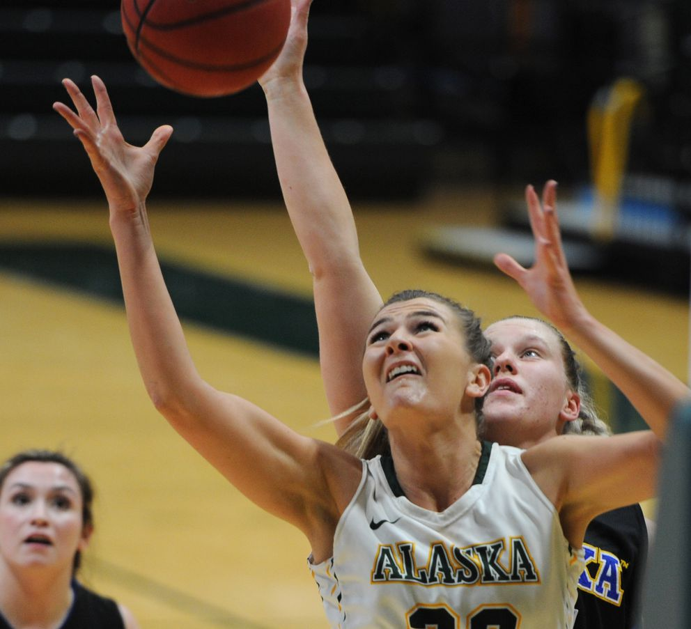 Hannah Wandersee reaches for a rebound in a January game against UAF. (Bill Roth / ADN)