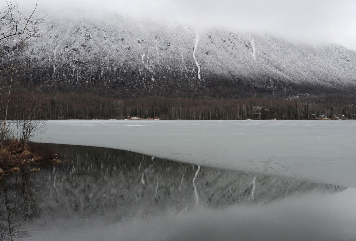 The slopes of Bear Mountain rise above Mirror Lake in April 2019. (Bill Roth / ADN)